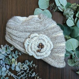 Warm knit striped beanie with beaded lace flower